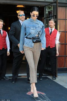 Only the best: The elder sister of Kylie Jenner wore sunglasses with hexagonal lenses and had got a black Prada fanny pack on, accenting her slender waistline