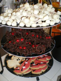 BONES-pretzel sticks, marshmellow ends, dipped in white chocolate.  SPIDERS-oriental noodles, dipped in chocolate w/ red hot eyes.  VAMPIRE COOKIES- football cookie cutter w/ side pushed in to create mouth.
