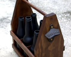 This beer caddy is made from pine and is a great way to take your six pack with you or display in your man cave. It has a beer opener on one end and the beer logo on both sides.
