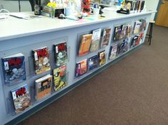 acrylic book displays attached to circ desk - could be used for brochures too. School Library Displays, School Library Design, Middle School Libraries, Elementary School Library, Class Library, Library Lessons, Library Books, Library Furniture Design, Library Inspiration