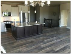 flooring porcelanato Loving my CoreTec Plus LVT flooring. We chose to use it in all areas including our baths! Grey Vinyl Plank Flooring, Laminate Flooring In Kitchen, Grey Wood Floors, Basement Flooring, Tile Flooring, Hardwood Floors, Black Kitchens, Home Kitchens, Home Renovation