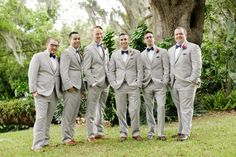 Groom and Groomsmen in Gray Suits - Navy and Pink Lakefront Wedding - Orange Blossom Bride - Photographer: Bumby Photography - Click Pin for More - www.orangeblossombride.com