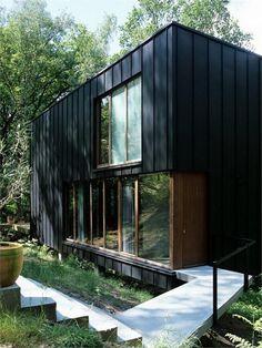 Black sheet metal and concrete walkway.