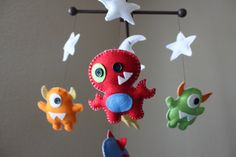 Baby Mobile - Baby Crib Mobile - Nursery Monsters Mobile - Aliens Mobile (You Can Pick Your Colors). $90.00, via Etsy.