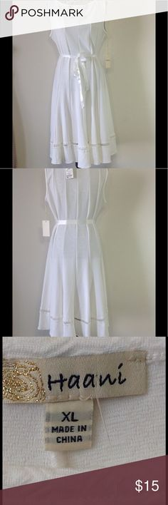 """A-LINE FLAIR DRESS #C-0049 White A-line ladies dress with lots of bottom flair. Sateen belt. Very stretchy. Bust line is 38"""" and stretches to 44"""" comfortably. Contours to waist which is a 32"""" relaxed and stretches to 40"""". Hips 44"""" and stretches to a 48"""". From shoulder to hem 43"""". HAANI Dresses Midi"""