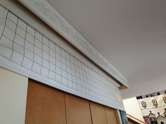 some great diy ideas for the quilting room - this is a pull down design wall