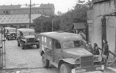 US Army Dodge WC54 Ambulances leaving the 28th General Hospital, Liège, Belgium, 1944