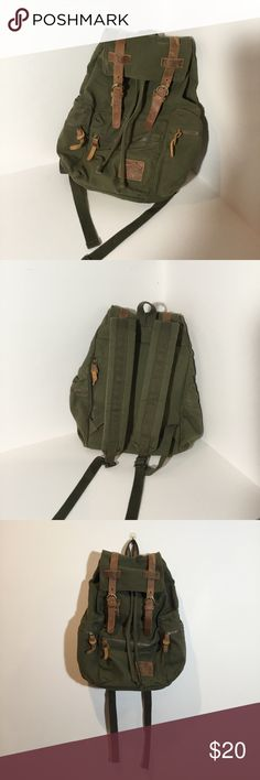Army Green Backpack Army green backpack with many pockets. The leather has some marks on it, but it goes with the look. This has been used, but is in great condition.  Depth: 17 in Width: 13 in  Outside: 1 front pocket with a zipper 1 back pocket with a zipper  Inside: 1 pocket in the back with a zipper 1 pocket in the front with a zipper 3 open pockets in the front 1 big compartment for a computer Bags Backpacks