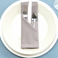 Learn how to keep your silverware stylishly snug in this easy napkin-folding video.