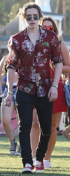 Bold: Brooklyn Beckham added a tropical touch to his Coachella look by rocking a patterned...