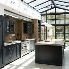 How gorgeous is this kitchen by deVOL? Having one wall made fully out of glass, as well as a glass roof, allows n abundance natural light to flood into the space.