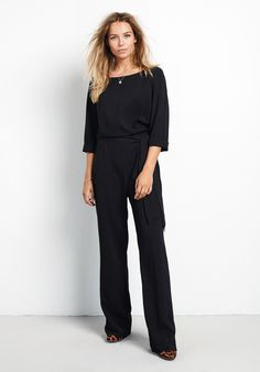 #AVERY Belted Jumpsuit #The chicest jumpsuit of the season with subtly flared hems and an elegant tie waist. The perfect desk-to-dinner piece, pair with our Sloane boots and Chandelier tassel earrings.Maxi length, with flared hems.Neat, slim fit. True to size.Side zip and back button closure.Scoop boat neck with elbow length sleeves.Model is 57 and wears size 8.