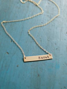 handstamped gold bar necklace