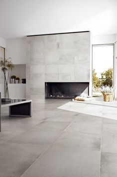 modern flooring Minimalist living area with gray ceramic floor tiles and modern fireplace Ceramic Wood Tile Floor, Concrete Look Tile, Wood Tile Floors, Porcelain Tiles, Porcelain Tile Flooring, Plywood Floors, Cement Tiles, Stained Concrete, Painted Floors