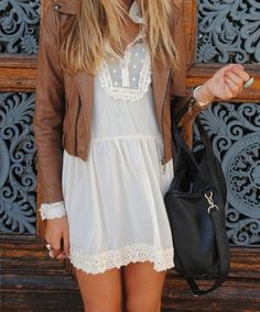 delicate little white dress with little leather jacket. Skirt length needs to be a little longer for me but love the combo/look!!