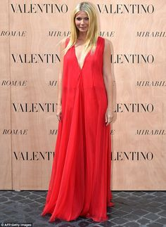 Simply chic: Gwyneth, 42, let the dress talk for itself by snubbing accessories and wearin...