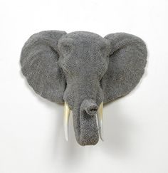 Courtney Timmermans, Urban Herd: Elephant, 2012  cast resin, air rifle BBs, mixed media  18 x 21 x 11 inches