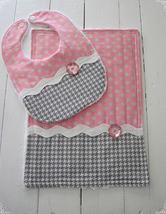 Pink and Gray Bib and Burp cloth set. Going to a baby shower? This set would be the perfect gift. Even though it is soft and snuggly, it is constructed to last! The burp cloth features double seaming around the edges, and the terry lining is super absorbent! Details: * All cotton