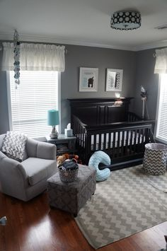 Cute grey baby room with black furniture