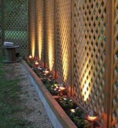 GREAT idea for a privacy fence that's easier on the pocketbook. Lattice to the height you want and the solar lights gives it the finished look.