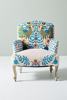 Vibrant flora and fauna lend a whimsical aesthetic to this plush chair. For product details, ordering assistance and more, speak with our furniture specialists by emailing… Funky Furniture, Plywood Furniture, Unique Furniture, Painted Furniture, Furniture Design, Furniture Stores, Furniture Outlet, Rustic Furniture, Furniture Removal