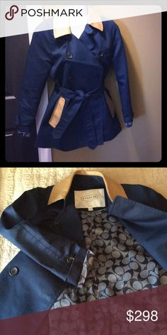 "COACH Navy blue short trench with tan leather trim Beautiful COACH ""short trench"" coat', size XS only worn once and in perfect condition!  The shell is 100% cotton in a navy blue, the lining is 100% polyester with the COACH branding throughout, and the trim is a 100% tan leather.  I found it to run a bit large.  Fits more like a small. Coach Jackets & Coats Trench Coats"
