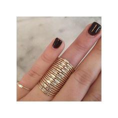 14k gold horizontal white diamond baguette ring SPECIFICS• 14k thin round ring band• baguette is 3x1½mm• white baguette diamond .06 ctw