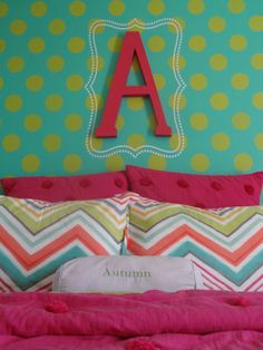 Green polka dot stencil pattern on blue wall for fun girl's room decor and design