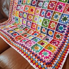 In stock ready for immediate dispatch. This colourful daisy inspired blanket has been crocheted in a gorgeous fresh primary colours. There are 100 daisy granny squares in total. All colours that will be sure to brighten up the day. Measuring 52 square approx. it is ideal for bed, on