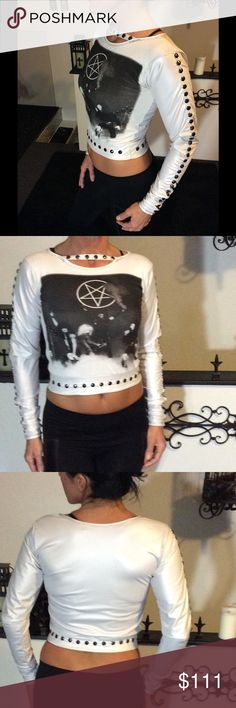 "Custom made ooak motley crue top Xs/small no trades unless u have something similar to offer ,,, one of a kind custom made top, made of a mix of a cotton front with motley crue graphics, and the sleeves amd back are a vinyl stretchy material faux leather , all white with silver grey grommets up the sleeves, and a choker like collar front, tried on but never worn out, best fit xs small my size 34ab n waist 26"" fits tight by design but does stretch, no lowballs i paid 150$ new serious offers…"