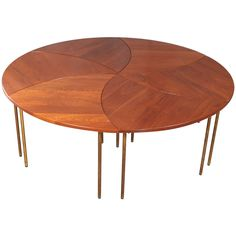 Peter Hvidt Set of Six Teak and Brass Tables   From a unique collection of antique and modern coffee and cocktail tables at https://www.1stdibs.com/furniture/tables/coffee-tables-cocktail-tables/