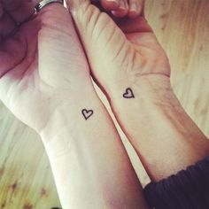 These small hearts holds very big meanings. It represents your heart to heart bond which the Purest Bonding anyone can have. It's one of the best tattoos to have with your mother | Mother Daughter Tattoos| 45 Soulful Mother Daughter Tattoos To Feel That Bond | Fenzyme.com