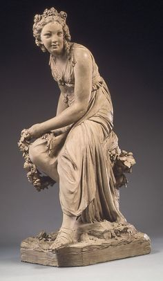 Flora. Louis-Claude Vassé  (French, Paris 1716–1772 Paris).  Date:     1764.     Red terracotta, buff colored wash over grey paint. Dimensions:     H. 23 in. (58.4 cm)