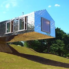 A cantilevered house in Suffolk, England, by MVDRV of Rotterdam and British firm Mole Architects