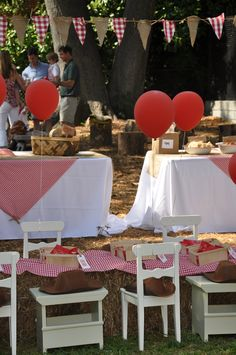 hay table for kids with red and white gingam-  love the pennants (maybe Mandy will make these?)  red balloons!