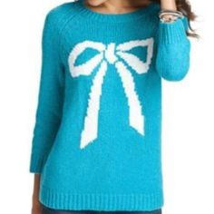 Ann Taylor Knit Bow Sweater Adorable sweater by Ann Taylor in gorgeous teal color with white bow. In size MEDIUM. In great condition, only worn once for a holiday party. Ann Taylor Sweaters Crew & Scoop Necks