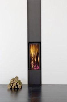 Slim modern wood stove.  Not sure what I think about this.