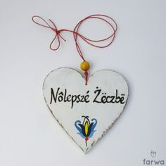 "Kaszubskie serduszko  ""Nôlepszé Żëczbë"" - ""Najlepsze życenia.The heart is cut from plywood, hand painted with acrylic paint and varnish protected. Suspended on a natural string. Dimensions: 10cm x 10cm ."