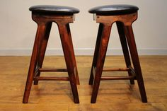 Pair of 1960's Rosewood Erik Buch Bar Stools – The frames have been cleaned and the seat pads have been re-upholstered in good quality black leather hide. Upon doing some research we identified that the stools originally had a low back rest. This had been removed at some point during the stools life, and unfortunately not to the highest standard. Our restorer has done a sterling job replacing a back strut using and vintage section of rosewood.InteriorBoutiques.com