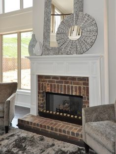 Brick Fireplace and white mantle