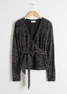 Long sleeve sequin wrap top with a side tie.Plunging v-neckLinedLength of top: / (size wears: EU UK US 4 / Small Clothes For Sale, Clothes For Women, Trouser Outfits, Wide Trousers, Evening Tops, Sustainable Clothing, Sequin Top, Fashion Story, Chic Outfits