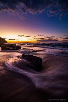 Hey everyone.  Noosa National Park!  This evening I'll be sharing an older shot from last year taken up at Noosa National Park at Sunset.  There was a really nice glow in the sky after the sun had set and it looked really cool so I got some shots of it with the water movement flowing around the rocks.  I hope you enjoy this image, Thanks for looking!