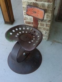 Tractor Seat Stool -- Grandparents had a line of these outside overlooking the drop at their cabin in Indiana. Remember going with Pappa Rollie to the junkyards to find them. All had the original curved springs on them, and that's the way he set them up. Sweet memory.