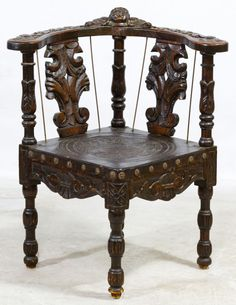 Lot 45: Victorian Carved Mahogany Corner Chair; Ornately carved corner arm chair with inserted leather seat