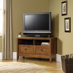 Corner TV Stand with front and side paneling and oiled oak finish.
