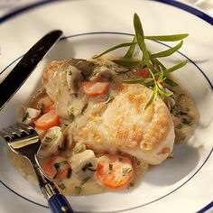 This Chicken Fricassee with Tarragon dish is first browned to a crispy coating, chicken breasts are then simmered in white wine and topped with a tangy mushroom and Dijon mustard cream sauce for a juicy, unexpected meal that clocks in at 400 calories per serving. #healthyrecipes #chickenrecipes #healthyeating #everydayhealth | everydayhealth.com