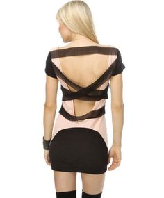 Okay, the front of this dress is totally normal. It looks like a LBD with cap sleeves. Then, she turns around and we've got more mesh criss-cross strips than most S&M wear! If your dress has a split-personality, you might regret it.