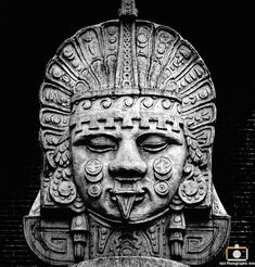 Peering from the darkness, the goddess Coyolxauhqui (coh-yohl-shau'-kee) is one of the most important deities in the world of the Aztecs. She is the moon goddess with copper bells on her cheeks. She is the sister of the sun-god Huitzilopochtli Mayan Tattoos, Maya Civilization, Aztec Culture, Inka, Aztec Warrior, Aztec Art, Chicano Art, Moon Goddess, Mexican Art
