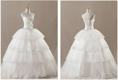 http://www.weodress.com/wedding-dresses/ivory-strapless-sequins-organza-wedding-dress-p-625.html#.Ujld83_I-0M