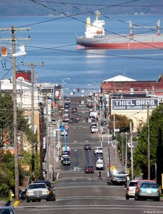 Astoria, Oregon ~ overlooks the Columbia River on its last massive surge to the Pacific Ocean